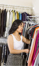 Mature woman dressing within walk-in closet Stock Photography