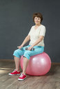 Mature woman with dumbbells Royalty Free Stock Photo
