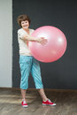 Mature woman with fitness ball smiling fit aged lady exercise Royalty Free Stock Photography