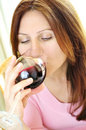 Mature woman with a glass of red wine Stock Photography