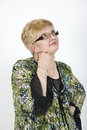 Mature woman with glasses thinking Royalty Free Stock Image