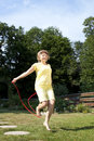 Mature woman has fun jumping rope with Royalty Free Stock Image