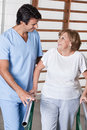 Mature woman having ambulatory therapy men with his therapist Royalty Free Stock Photos