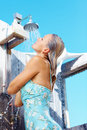 Mature woman having a shower, outdoors Royalty Free Stock Images