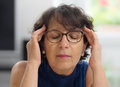 stock image of  Mature woman with a headache
