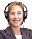 Mature woman on headphones listening to music Royalty Free Stock Photo
