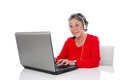 Mature woman with headset elder woman isolated on white backgr in red computer Royalty Free Stock Photos