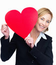 Mature woman holding heart on white background Royalty Free Stock Photography