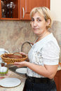 Mature woman holding plate with bread Royalty Free Stock Photography