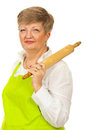 Mature woman holding rolling pin Stock Photo