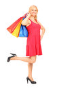 Mature woman holding shopping bags Royalty Free Stock Image