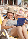 Mature woman  with laptop at  beach Royalty Free Stock Photos