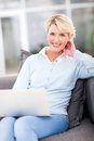 Mature woman laptop beautiful using computer at home Royalty Free Stock Image