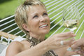 Mature Woman With Man Holding Wine Glass Stock Images