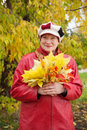 Mature woman with maple posy Royalty Free Stock Photos