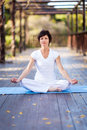 Mature woman meditation Royalty Free Stock Image