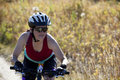 Mature woman mountain biker Stock Images