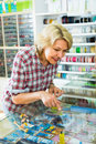 Mature woman near glass showcase in boutique Royalty Free Stock Photo