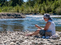 Mature Woman outdoors on river bank Royalty Free Stock Photo