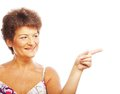 Mature woman pointing over white background Royalty Free Stock Image