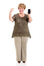 Mature woman pointing smart phone happy at on white background Royalty Free Stock Photo