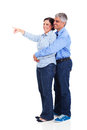 Mature woman pointing women at copyspace with her husband isolated on white background Stock Photography