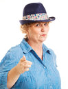 Mature woman points at camera portrait of a pointing the isolated on white Royalty Free Stock Photo