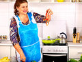 Mature woman preparing at kitchen. Royalty Free Stock Images
