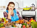 Mature woman preparing at kitchen food Stock Images