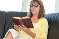 Mature woman reading a book Royalty Free Stock Photo