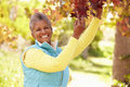 Mature woman relaxing in autumn landscape smiling Royalty Free Stock Photos