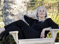 Mature woman relaxing outdoors Royalty Free Stock Photo