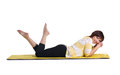 Mature woman resting laughing lying on rubber yellow matting isolated on white Royalty Free Stock Photos