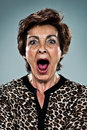 Mature woman shouting over grey background Royalty Free Stock Images