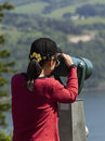 Mature woman sight seeing through telescope vertical photo of looking at columbia river gorge located in the northwest section of Stock Photography