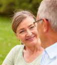 Mature woman smiling at her husband Stock Photography