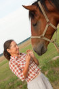 Mature woman stands next to horse Royalty Free Stock Photography