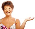 Mature woman stretching her hand on wh place your product here old white Royalty Free Stock Photos