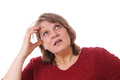 Mature woman thinking senior scratching her head Royalty Free Stock Photo