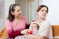 Mature woman tries reconcile with adult daughter women baby after quarre Stock Image