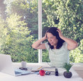 Mature woman upset will working in the morning from home Royalty Free Stock Photo