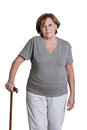 Mature woman with walking stick portrait of Stock Photography