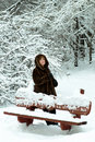 Mature woman in a winter forest Stock Images