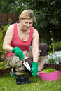 Mature woman works in her garden,new plants Royalty Free Stock Photo