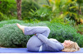 Mature woman in yoga position Royalty Free Stock Photography