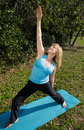 Mature Woman Yoga - Upward Warrior Royalty Free Stock Photos