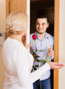 Mature woman and young guy at doorway Royalty Free Stock Photo