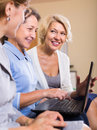 Mature women working with documents Royalty Free Stock Photo