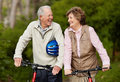 Matured couple with bicycle in countryside Royalty Free Stock Photo