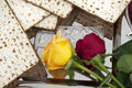 Matza bread for passover celebration roses and Royalty Free Stock Images